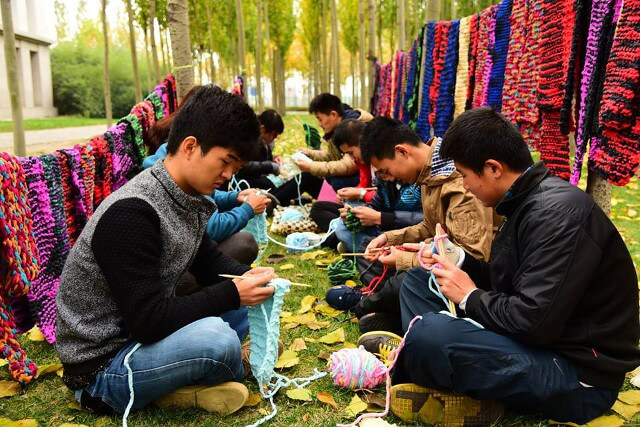 Students Knit 500 Scarves for City Workers
