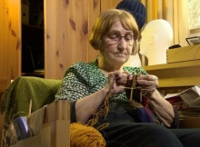 Senior losing housing subsidy over knitting
