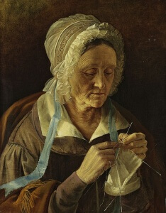 old woman knitting socks